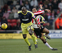 Photo: Lee Earle.<br /> Southampton v Derby County. Coca Cola Championship. 04/02/2006. Derby's Darren Moore (L) battles with Dexter Blackstock.