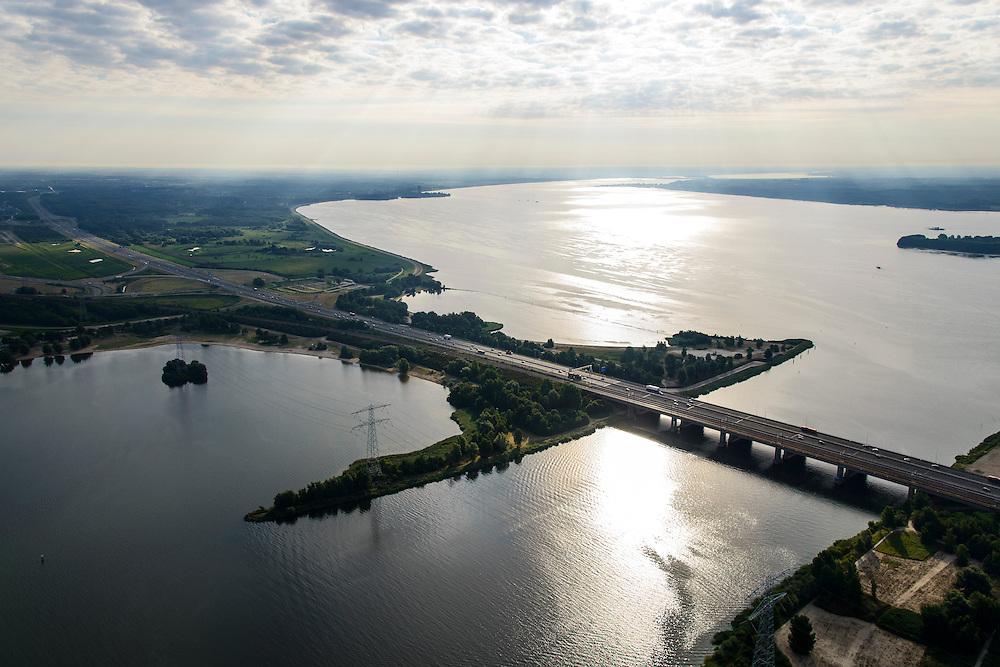 Nederland, Flevoland, Almere, 27-08-2013; Hollandse brug, A6<br /> verbindt Noord-Holland met Flevoland. In de verte ligt Almere. Rechts van de brug het Eemmeer, links het Gooimeer.<br /> Hollandse brug (bridge) connects the provinces of North Holland and Flevoland. <br /> luchtfoto (toeslag op standaard tarieven);<br /> aerial photo (additional fee required);<br /> copyright foto/photo Siebe Swart.