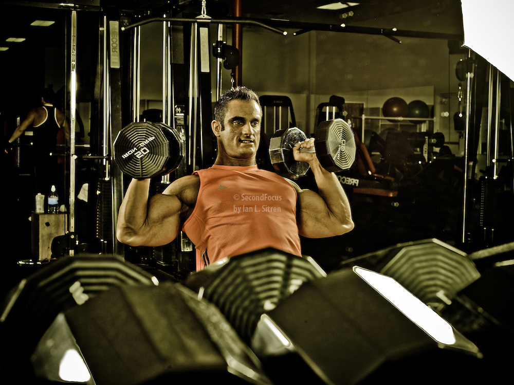Bodybuilder Dan Decker working out in the gym.