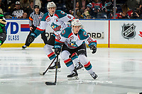 KELOWNA, CANADA - JANUARY 19: Kaedan Korczak #6 and Conner Bruggen-Cate #20 of the Kelowna Rockets skate against the Prince Albert Raiders on January 19, 2019 at Prospera Place in Kelowna, British Columbia, Canada.  (Photo by Marissa Baecker/Shoot the Breeze)