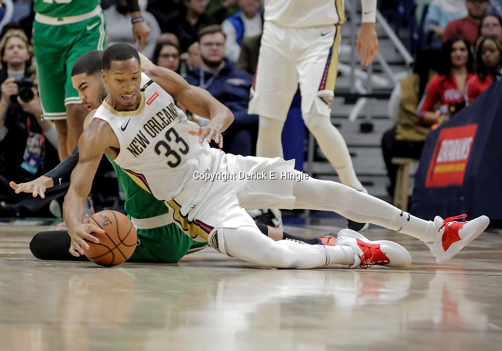 Nov 26, 2018; New Orleans, LA, USA; New Orleans Pelicans forward Wesley Johnson (33) and Boston Celtics forward Jayson Tatum (0) scramble for a loose ball during the first quarter at the Smoothie King Center. Mandatory Credit: Derick E. Hingle-USA TODAY Sports