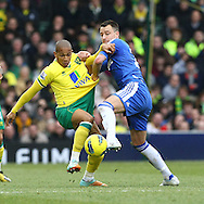 Picture by Paul Chesterton/Focus Images Ltd.  07904 640267.21/01/12.Simeon Jackson of Norwich and John Terry of Chelsea in action during the Barclays Premier League match at Carrow Road Stadium, Norwich.