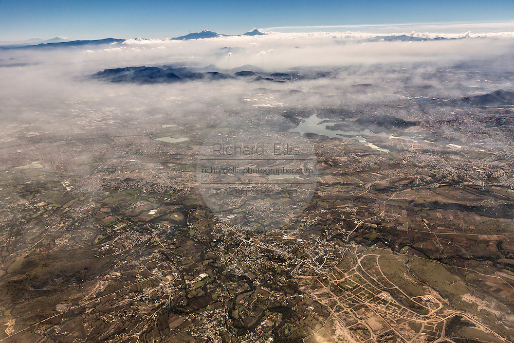 Aerial view of urban sprawl and smog November 6, 2013 in Mexico City, Mexico