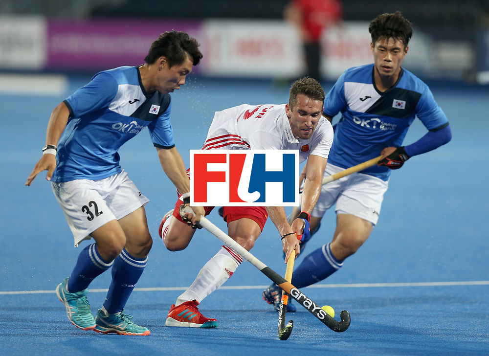 LONDON, ENGLAND - JUNE 20: Jihun Yang of South Korea and Hoon Kim Ki of South Korea attempt to tackle David Condon of England during the Pool B match between India and the Netherlands on day six of the Hero Hockey World League Semi-Final at Lee Valley Hockey and Tennis Centre on June 20, 2017 in London, England.  (Photo by Alex Morton/Getty Images)