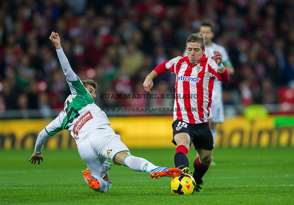 BILBAO, SPAIN - OCTOBER 31: Iker Muniain (R) of&Ecirc;Athletic Club Bilbao&Ecirc;competes for the ball with Ruben Perez (L) of Elche FC during the La Liga match between&Ecirc;Athletic Club Bilbao&Ecirc;and&Ecirc;Elche FC at&Ecirc;San Mames Stadium<br /> on  October 31, 2013 in Bilbao, Spain.  (Photo by Juan Manuel Serrano Arce/Getty Images)