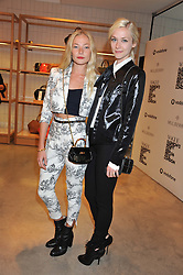 Left to right, CLARA PAGET and PORTIA FREEMAN at a party to celebrate the launch of the Vogue Fashion's Night Out held at Mulberry, Bond Street, London on 6th September 2012.
