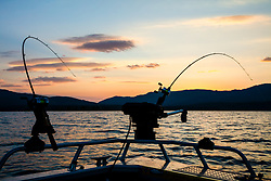 """""""Fishing Poles at Stampede Reservoir"""" - Sunrise photograph of two fishing poles and a down rigger at Stampede Reservoir, north of Truckee, California."""