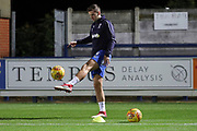 AFC Wimbledon defender Ben Purrington (3) warming up during the EFL Trophy group stage match between AFC Wimbledon and Stevenage at the Cherry Red Records Stadium, Kingston, England on 6 November 2018.