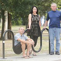 Clark Milioti, left, Catherine Milioti, center, and Pete Larkin pose for a photo Monday November 2, 2015 at Sunset Beach Park in Sunset Beach, N.C. (Jason A. Frizzelle)