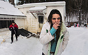 """Pownal, VT -  Friday, Feb. 7, 2014:   Brianna Wasieleuski, 11, left, looks on as her sister recovering addict Stephanie Predel, 23, right, has a smoke outside their house.   Federal studies show that Vermont has one of the highest per capita uses of illicit drugs. """"There's just nothing here,"""" said Stephanie Predel, 23, who went from painkillers to heroin, hiding her habit from her children by shooting up in the bathroom. """"Come wintertime, everybody just sits inside using."""" Stephanie, who says she has not used heroin since November, has lost custody of her children. She has no job and no home and for now is staying with her mother, Jennifer Rose, 42, who blames herself for her daughter's descent into drugs. """"Because I had a dysfunctional family growing up, I did a poor job of bringing her up,"""" Ms. Rose said. She said she did not know how to break the cycle.  CREDIT: Cheryl Senter for The New York Times"""