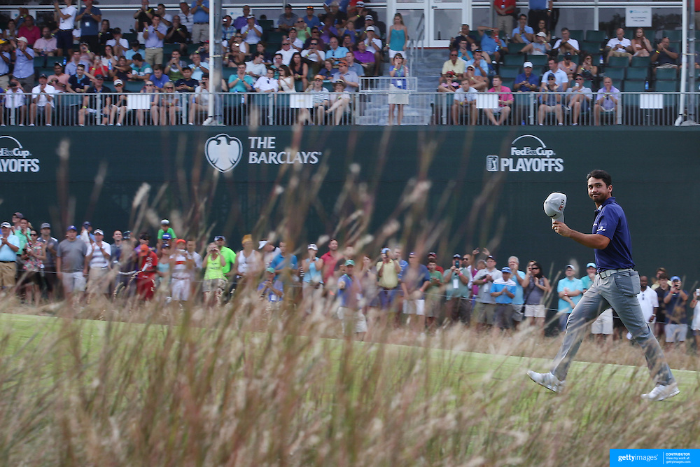 Jason Day, Australia, ackowledges the crowd as he walks up the final fairway during the final round while winning the The Barclays Golf Tournament by six shots at The Plainfield Country Club, Edison, New Jersey, USA. 30th August 2015. Photo Tim Clayton