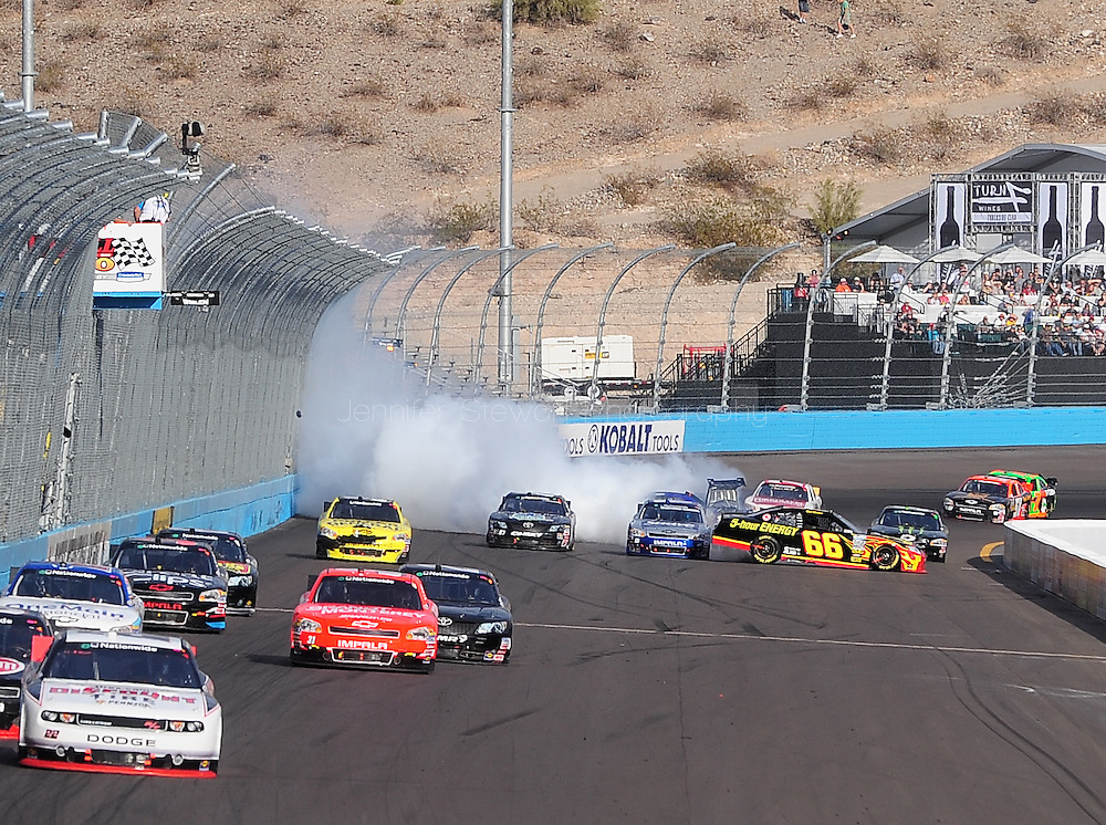 Nov. 12 2011; Avondale, AZ, USA; NASCAR Nationwide Series driver Steve Wallace (66) looses control of his car during the Wypall 200 at Phoenix International Raceway. Mandatory Credit: Jennifer Stewart-US PRESSWIRE