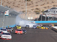 Nov. 12 2011; Avondale, AZ, USA; NASCAR Nationwide Series driver Steve Wallace (66) looses control of his car during the Wypall 200 at Phoenix International Raceway. Mandatory Credit: Jennifer Stewart-US PRESSWIRE
