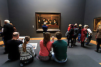 Visitors enjoying the artwork at the Rijksmuseum in Amsterdam, The Netherlands