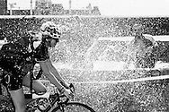 Picture by Andrew Tobin/Tobinators Ltd +44 7710 761829<br /> 04/08/2013<br /> Bathers splash a lady rider to cool down during the Cycle Messenger World Championships held in Lausanne, Switzerland. Started in 1993 by Achim Beier from Berlin, the championships are not only a sporting contest but an opportunity to unite friends and bicycle enthusiasts worldwide. The event comprises a number of challenges including a sprint, a track stand (longest time stationary on the bike), a cargo race where heavy loads are carried on special bikes, and the main race. The course winds through central Lausanne and includes bridges, stairs, cobbles, narrow alleyways and challenging hills. The main race simulates the job of a bike courier making numerous drops and pickups across the city. Riders need to check in at specific checkpoints, hand over their delivery and get a new one. The main race can take up to 4 hours for each competitor to complete.