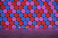 © Licensed to London News Pictures. 18/06/2018. London, UK. Ducks pass close to artist Christo's latest work 'The Mastaba' is unveiled on The Serpentine in Hyde Park. The 20m high installation, made up of 7,506 horizontally stacked barrels, is 30m wide and 40m long. Photo credit: Peter Macdiarmid/LNP