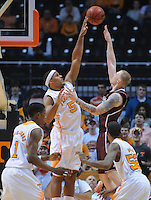 Jan 19, 2013; Knoxville, TN, USA; Mississippi State Bulldogs forward Colin Borchert (3) shoots the ball over Tennessee Volunteers forward Jarnell Stokes (5) during the first half at Thompson-Boling Arena. Mandatory Credit: Randy Sartin-USA TODAY Sports