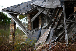 03 December 2013. Lower 9th Ward, New Orleans, Louisiana. <br /> One of the many derelict, abandoned buildings damaged by hurricane Katrina 8 years previously slowly decomposes and collapses. Vacant lots and falling down buildings continue to inhabit the landscape.<br /> Photo; Charlie Varley