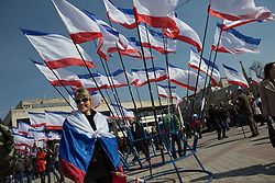 Crimea one day before the referendum. A girls stands in front of dozens of Crimean flags in a pro Russian rally at Simferopol's Lenin Square. Simferopol, . Saturday, 15th March 2014. Picture by Daniel Leal-Olivas / i-Images