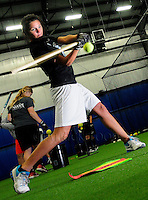 Liz Schaller of Kewaskum, a member of the Marian University softball team, practices with her teammates in the newly constructed Lenz field house on the East end of the campus. Friday, April 20, 2012. The Reporter photo by Patrick Flood.