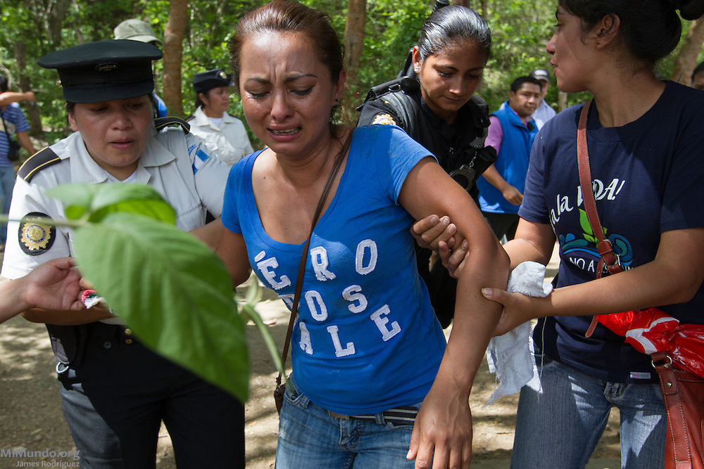 "Maria del Rosario Rosales, who is pregnant, cries out: ""They dragged me like an animal! And I am pregnant!"" After two years and two months of peacefully blocking the entrance to U.S.-based Kappes, Cassiday & Associates (KCA) El Tambor gold mine, local residents of San Jose del Golfo and San Pedro Ayampuc were violently evicted by Guatemalan Police forces in order to introduce heavy machinery inside the industrial site. La Puya, San Pedro Ayampuc, Guatemala. May 23, 2014."