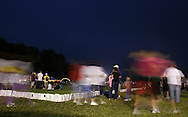 Pine Bush, New York - People from the Pine Bush community participate in the Relay for Life on Saturday, June 12, 2010. The Relay for Life is the American Cancer Society's largest fundraising event. Luminaries in memory of someone who lost their battle against cancer or in honor of a survivor of the disease line the track people walk around.