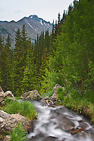 Cascading Tyndall Creek with Longs Peak in the distance at Rocky Mountain National Park, Colorado.