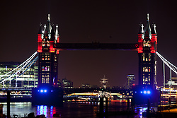 © Licensed to London News Pictures. 15/05/12. London, UK.  Colourful testing of the new Olympic lights on Tower Bridge , alternating between red, green and purple on the top towers. The white suspension cables at the sides were lit in white and new purple lights were in place at the bottom of the towers. Photo credit : Vickie Flores/LNP