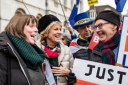 Caption correction © Licensed to London News Pictures. 10/01/2019. London, UK. Labour MP Jess Phillips (L) stands with Conservative MP Anna Soubry and pro- and anti-Brexit protesters opposite Parliament. Photo credit: Rob Pinney/LNP