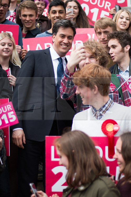 """© Licensed to London News Pictures. 04/05/2015. Brighton, UK. Labour Party leader Ed Miliband at the Brighton Hove and Sussex Sixth Form College putting the NHS at the heart of their run up to polling day by. He highlights a report commissioned by the Department of Health by asking the Conservatives party why it has not been published. Cookery writer Delia Smith CBE who this week has made a fervent plea to voters to back Labour and save the NHS from """"grave danger"""" showed her support for the event alongside Ed Balls. Photo credit : Hugo Michiels/LNP"""