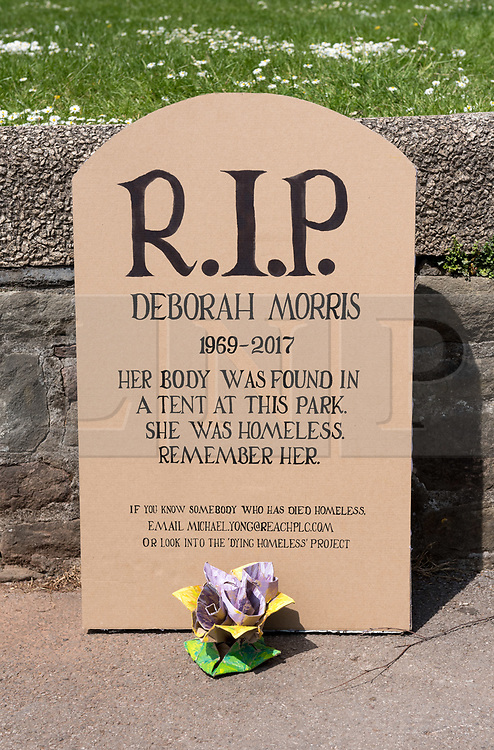 """© Licensed to London News Pictures. 15/05/2019. Bristol, UK. A tribute to a homeless woman who died in 2017 has been left in Castle Park in the city centre. The model headstone is for Deborah Morris who was found dead in a tent in the park on 28 May 2017 aged 48. She had been living in a high-support hostel for 10 months before her death. The cause of her death was not found. The tribute reads: """"R.I.P Deborah Morris. 1969 - 2017. """"Her body was found in a tent at this park. She was homeless. Remember her."""" There is also a message that if anyone knows someone who has died in the park to contact former Bristol Live journalist Michael Yong. 17 homeless people died in Bristol in 2017, the same year as Deborah Morris, which accounted for approximately a third of homeless deaths across the entire of the South West. Bristol also had the third highest number of deaths in England and Wales, alongside Lambeth and Liverpool, according to the Office for National Statistics (ONS). Photo credit: Simon Chapman/LNP"""