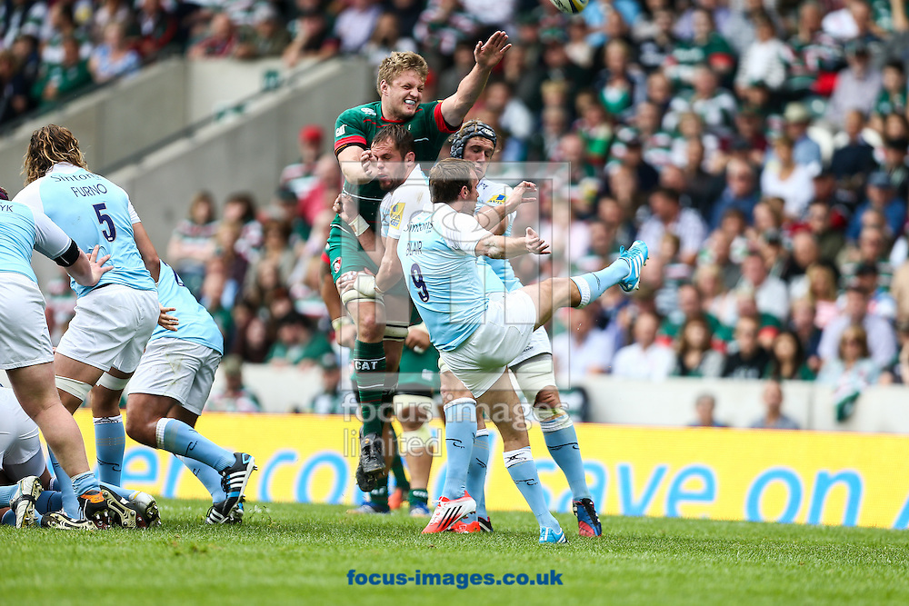 Mike Blair of Newcastle Falcons (right) makes a clearing kick during the Aviva Premiership match at Welford Road, Leicester<br /> Picture by Andy Kearns/Focus Images Ltd 0781 864 4264<br /> 06/09/2014