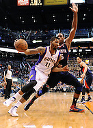 Mar. 1, 2013; Phoenix, AZ, USA; Phoenix Suns forward Markieff Morris (11) drives the ball against the Atlanta Hawks center Al Horford (15) in the second half at US Airways Center. The Suns defeated the Hawks 92-87. Mandatory Credit: Jennifer Stewart-USA TODAY Sports