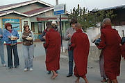 Myanmar Shan state Keng Tung AKA Chiang Tung, Priests receiving food donation from the towns people