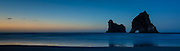 Panoramic of Archway Islands at dusk, Wharariki Beach, New Zealand.