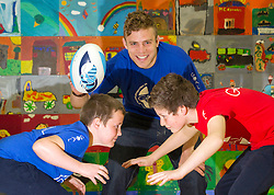 No Repro Fee: 10/04/13.Blues and Reds go Head to Head..Leinster star Ian Madigan surprises school kids for GOAL..Pictured here is Leinster out-half Ian Madigan wih Conor O'Neill (left), age 12, Adam Klug, age 12..The boys and girls of Kill O' The Grange primary school in Deansgrange got a big surprise when Leinster and Ireland rugby star, Ian Madigan paid them a surprise visit to launch a new annual fundraiser for GOAL on 10/04/13. Madigan was helping the aid agency promote their 'GOAL Sports Challenge', a multi-sport event that hopes to boost fitness levels amongst children and teenagers, and also raise money and awareness for some of GOAL's programmes for vulnerable children throughout the developing world..For schools interested in signing up, please email schools@goal.ie for further information about GOAL's work go to www.goal.ie , www.facebook.com/goalireland , @GOALIreland ..Pic: Andres Poveda