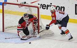 April 24, 2012; Newark, NJ, USA; New Jersey Devils goalie Martin Brodeur (30) makes a save on Florida Panthers left wing Marco Sturm (16) during the second period of game six of the 2012 Eastern Conference quarterfinals at the Prudential Center.