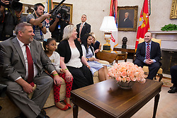 Joshua Holt(right) attends a meeting with members of his family including his father Jason Holt(left), daughter Marian Leal (2nd left), mother Laurie Holt(2nd right) and spouse Thamara Caleño with United States President Donald J. Trump upon his return to the U.S. at The White House in Washington, DC, May 26, 2018. Holt, was released from prison in Venezuela following diplomat efforts by the Obama and Trump administrations. Credit: Chris Kleponis / CNP