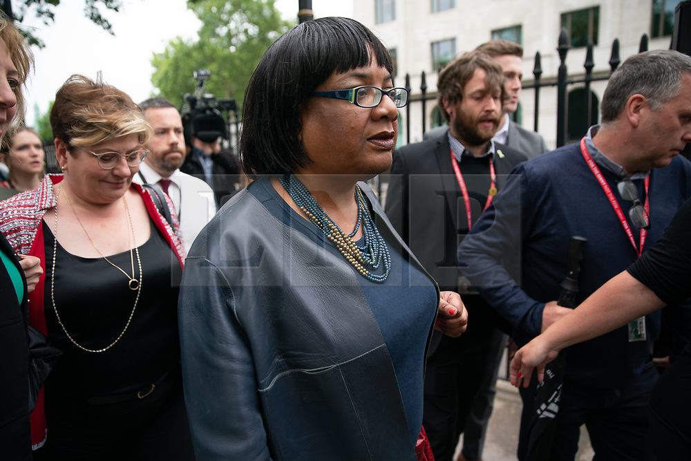 © Licensed to London News Pictures. 04/06/2019. London, UK. Shadow Home Secretary Diane Abbott walks to a demonstration on Whitehall where Leader of the Labour Party Jeremy Corbyn made a speech, protesting against the President of the United States of America, who was in Downing Street having a meeting with British Prime Minister Theresa May as part of a state visit to the UK. Photo credit : Tom Nicholson/LNP