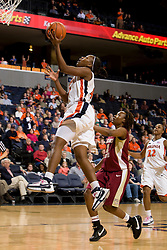 Virginia guard Enonge Stovall (40) shoots a layup past Florida St. guard Alysha Harvin (2).  The Virginia Cavaliers women's basketball team defeated the Florida State Seminoles 77-58 at the John Paul Jones Arena in Charlottesville, VA on February 10, 2008.