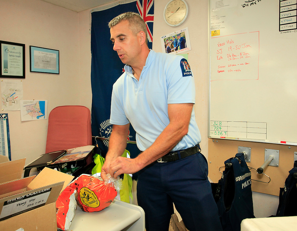 New Brighton Police packaging parcels including donations from 500 Friends and the Farmy Army to donate to 50 local families the Police have been working closely with,  Christchurch, New Zealand, Friday, December 16, 2011.  Credit:SNPA / Pam Johnson
