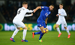 Islam Slimani of Leicester City battles for the ball with Alfie Mawson of Swansea City - Mandatory by-line: Alex James/JMP - 12/02/2017 - FOOTBALL - Liberty Stadium - Swansea, England - Swansea City v Leicester City - Premier League