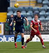10th August 2019; Dens Park, Dundee, Scotland; SPFL Championship football, Dundee FC versus Ayr; Jordan McGhee of Dundee clears from Luke McCowan of Ayr United