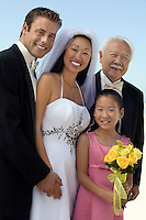 Bride and Groom with father and sister outdoors (portrait)