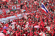 Mar. 28, 2010 - BANGKOK, THAILAND: Red Shirt protestors gather at the gates of the 11th Infantry Regiment barracks in Bangkok Sunday. More than 10,000 anti government Red Shirt protestor picketed the entrance to the Royal Thai Army's 11th Infantry Regiment Sunday in a continuation of protests that started March 21. The Red Shirts won a key victory Sunday when Thai Prime Minister Abhisit Vejjajiva agreed to negotiate with the protest leaders. The Red Shirts support former Prime Minister Thaksin Shinawatra, who was deposed in a coup in 2006 and went into exile rather than go to prison after being convicted on corruption charges. Thaksin is still enormously popular in rural Thailand. PHOTO BY JACK KURTZ