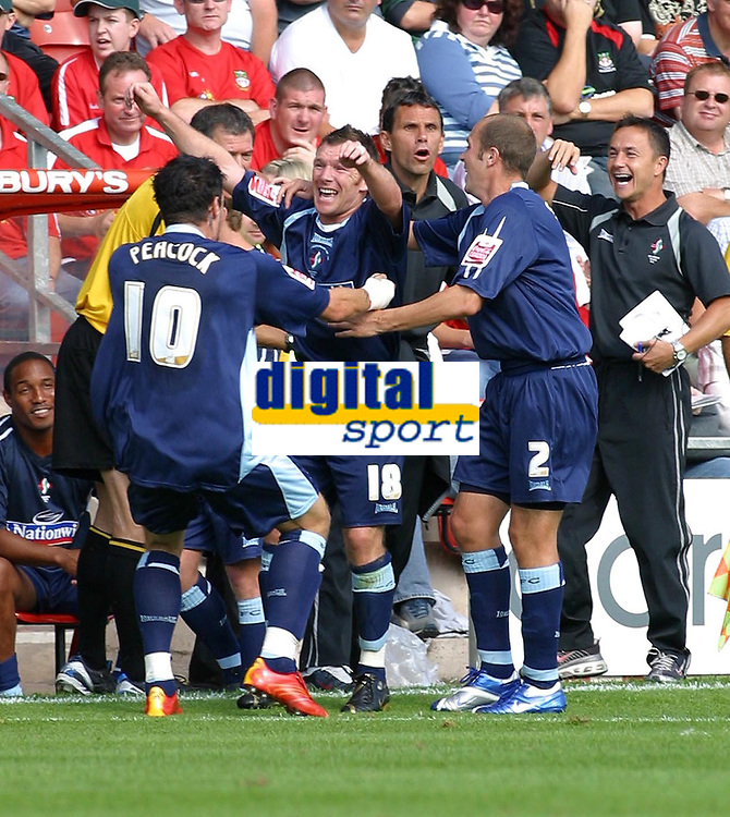 Photo: Dave Linney.<br />Wrexham v Swindon Town. Coca Cola League 2. 09/09/2006. Swindon's .Paul Evans(C) celebrates afer scoring, with a happy Dennis Wise looking on.
