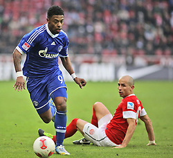 16.02.2013, Coface Arena, Mainz, GER, 1. FBL, 1. FSV Mainz 05 vs FC Schalke 04, 22. Runde, im Bild v.l.: Michel Bastos (S04) gegen Elkin Soto (MZ) // during the German Bundesliga 22th round match between 1. FSV Mainz 05 and FC Schalke 04 at the Coface Arena, Mainz, Germany on 2013/02/16. EXPA Pictures © 2013, PhotoCredit: EXPA/ Eibner/ Matthias Neu ***** ATTENTION - OUT OF GER *****