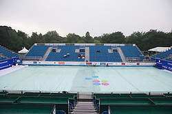 LIVERPOOL, ENGLAND - Thursday, June 20, 2013: Covers protect the court from the rain during the Day One at the Liverpool Hope University International Tennis Tournament at Calderstones Park. (Pic by David Rawcliffe/Propaganda)