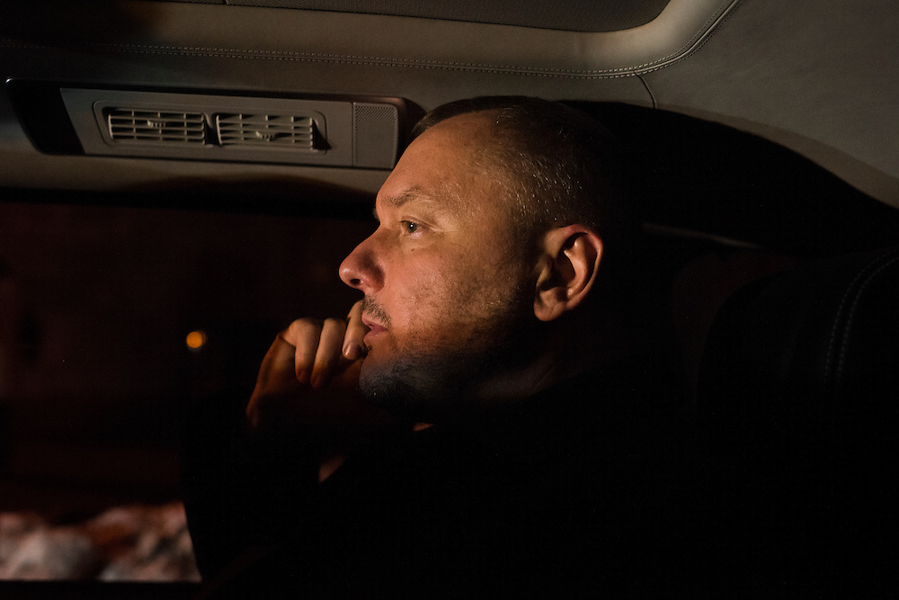 Andrey Artemenko rides in the back seat of his car on the way to an event on February 22, 2017 in Kiev, Ukraine
