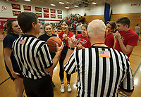 "Referees Bob Salome and Jim Presher go over tournament rules with Team Tautkis and Team LHS Honor Society for their three on three 15 minute game at the ""Ballin' for Bob"" Tournament for Hope at Laconia High School Saturday.   (Karen Bobotas/for the Laconia Daily Sun)"